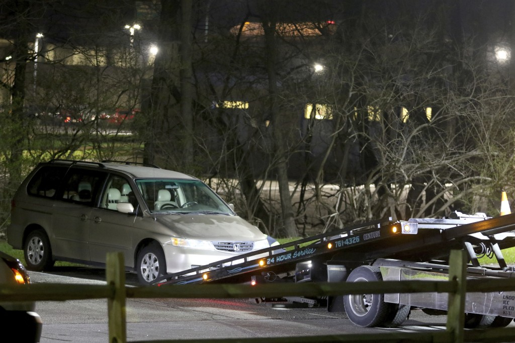 FILE - In this April 10, 2018 file photo, a minivan is removed from the parking lot near the Seven Hills School campus in Cincinnati.  Findings and re
