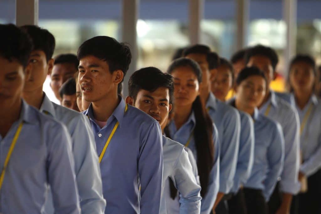 Cambodian students enter into the courtroom before the hearings against two former Khmer Rouge senior leaders, at the U.N.-backed war crimes tribunal