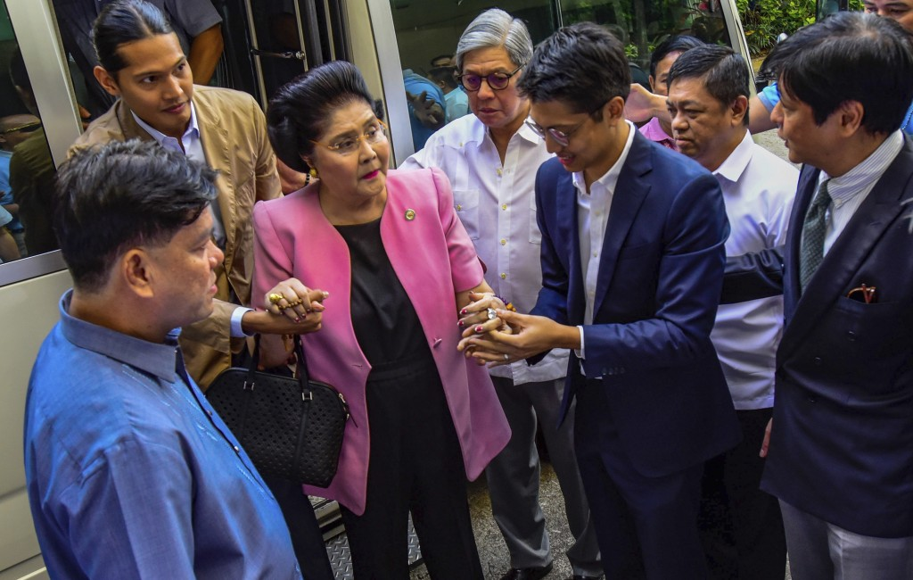 Former Philippine First Lady Imelda Marcos arrives at an anti-graft court Sandiganbayan to explain her side for not attending last week's promulgation