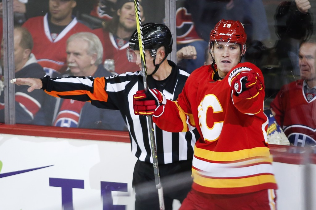 Calgary Flames' Matthew Tkachuk celebrates his goal against the Montreal Canadiens during the second period of an NHL hockey game Thursday, Nov. 15, 2...