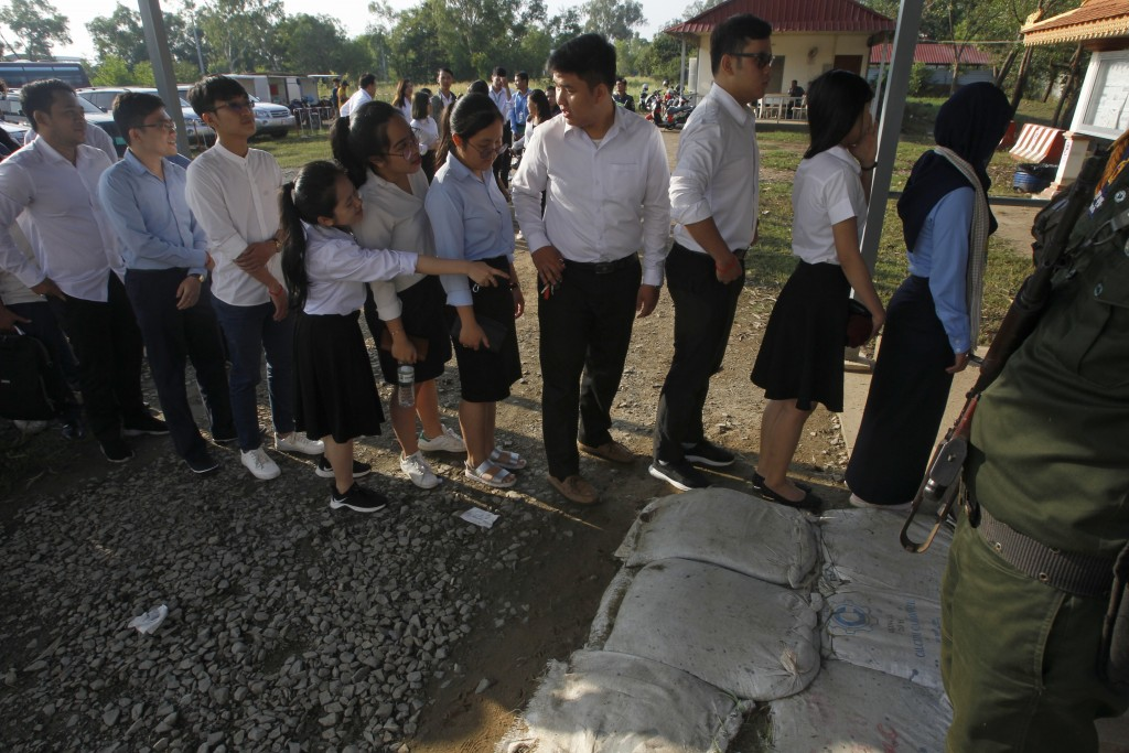 Cambodian students enter into the courtroom before the hearings against two former Khmer Rouge senior leaders, at the U.N.-backed war crimes tribunal ...