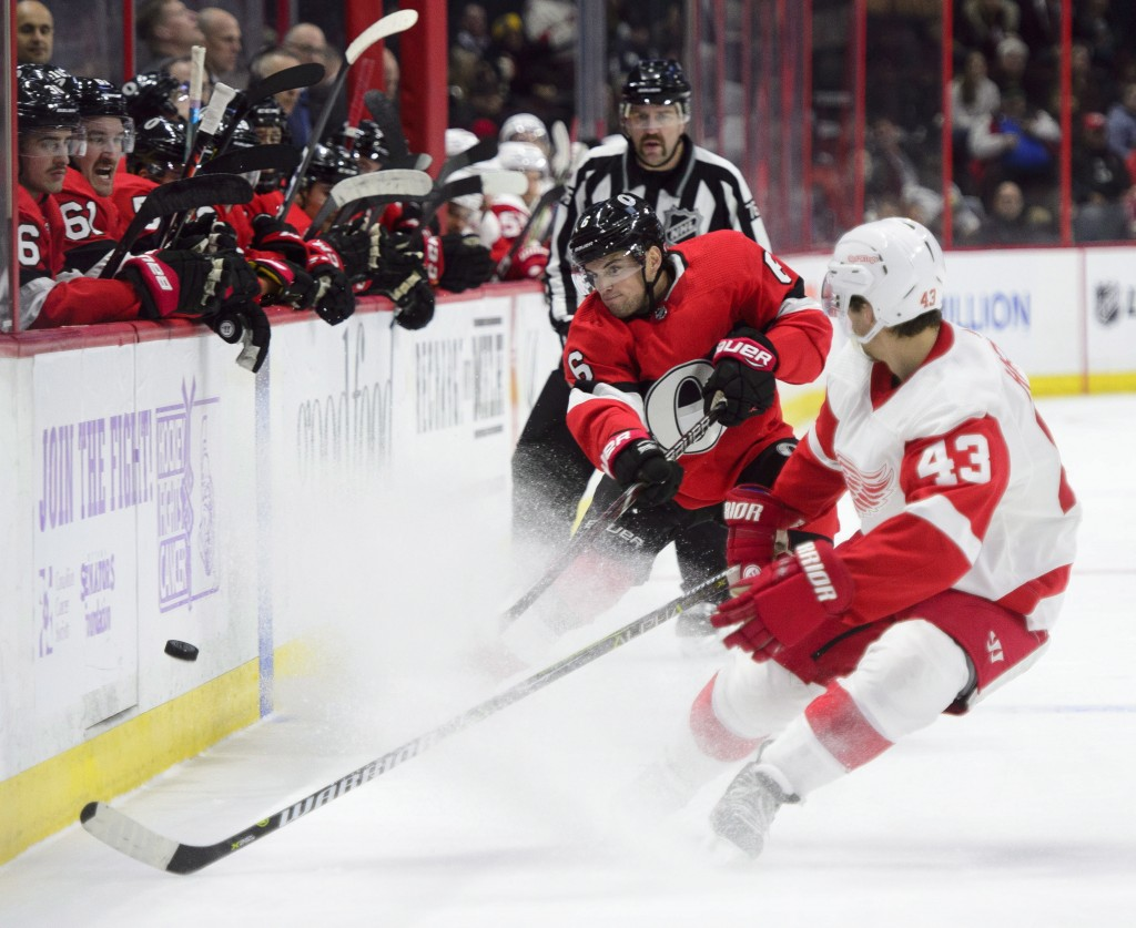 Ottawa Senators defenseman Chris Wideman (6) blasts the puck past Detroit Red Wings left wing Darren Helm (43) during the second period of an NHL hock