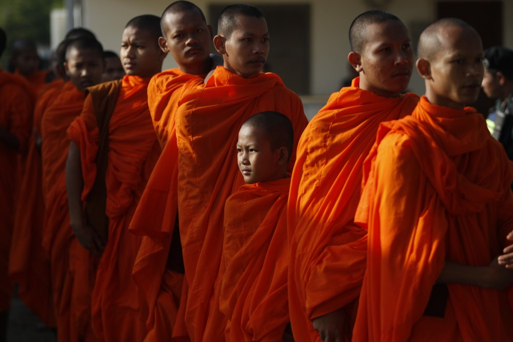 Cambodian Buddhist monks wait in queue to enter into the courtroom before the hearings against two former Khmer Rouge senior leaders, at the U.N.-back