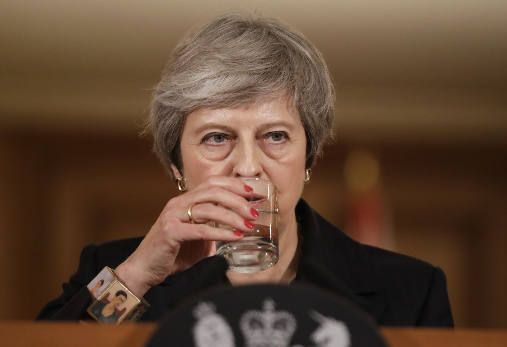 Britain's Prime Minister Theresa May takes a drink of water during a press conference inside 10 Downing Street in London, Thursday, Nov. 15, 2018. Two