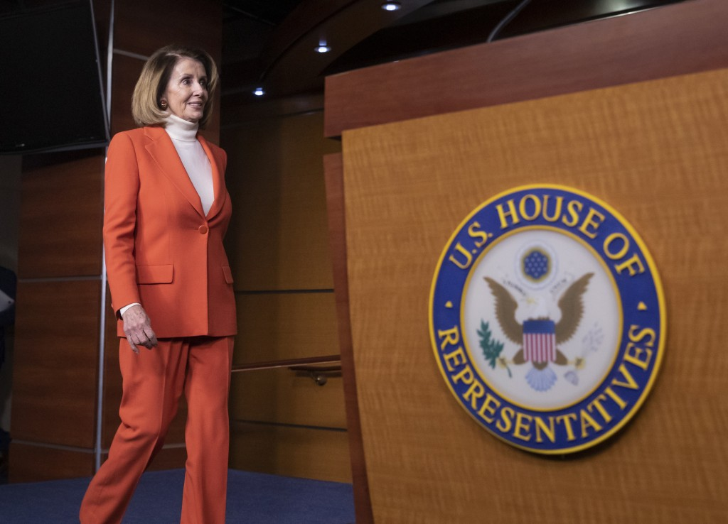 House Minority Leader Nancy Pelosi, D-Calif., arrives to face reporters at a news conference at the Capitol in Washington, Thursday, Nov. 15, 2018. (A