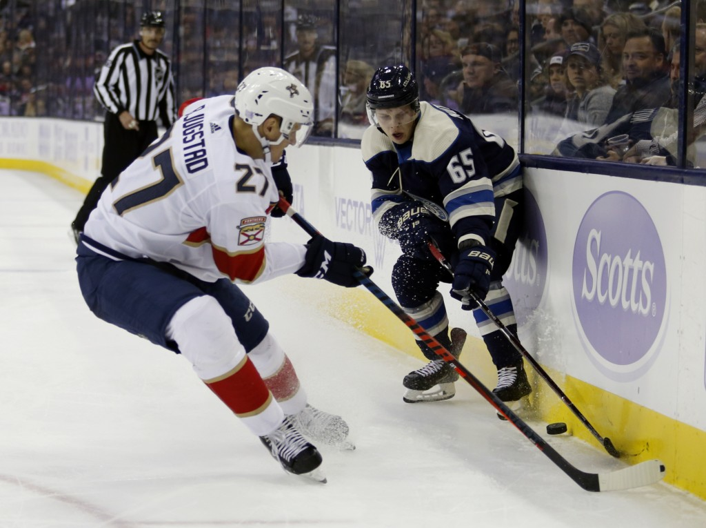 Columbus Blue Jackets defenseman Markus Nutivaara, right, of Finland, works against Florida Panthers forward Nick Bjugstad during the second period of...