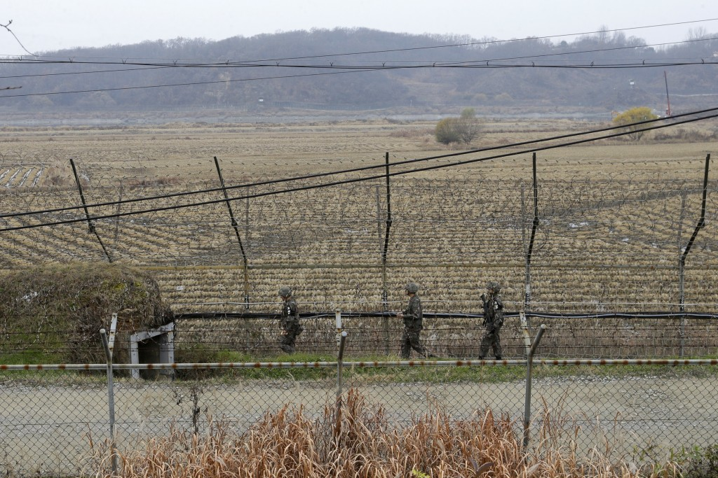 South Korean army soldiers patrol along the barbed-wire fence in Paju, South Korea, near the border with North Korea, Friday, Nov. 16, 2018. North Kor...