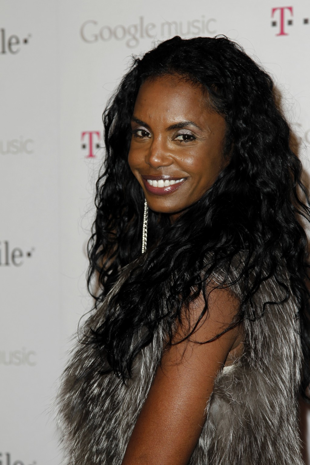 File-This Nov. 16, 2011, file photo shows Kim Porter arriving at the Google and T-Mobile party celebrating the launch of Google Music, in Los Angeles....