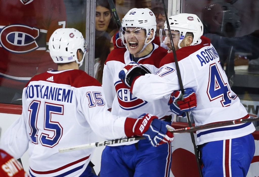 Montreal Canadiens' Artturi Lehkonen, (62) of Finland, celebrates his goal against the Calgary Flames with teammates during the third period of an NHL