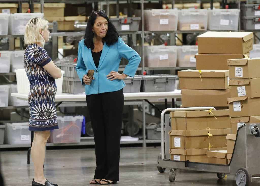 Palm Beach County Supervisor Of Elections Susan Bucher, right, talks to an employee at the Supervisor of Elections office during a recount, Thursday, ...
