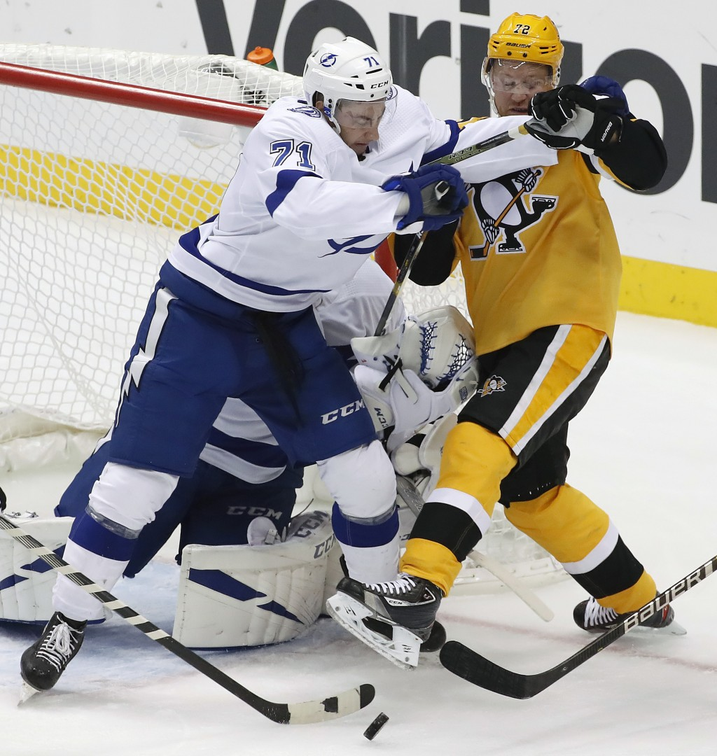Pittsburgh Penguins' Patric Hornqvist (72) works against Tampa Bay Lightning's Anthony Cirelli (71) in front of Lightning goalie Louis Domingue during...