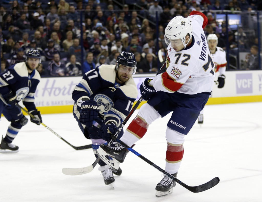 Florida Panthers forward Frank Vatrano, right, gets tangled up with Columbus Blue Jackets forward Brandon Dubinsky, center, during the first period of...