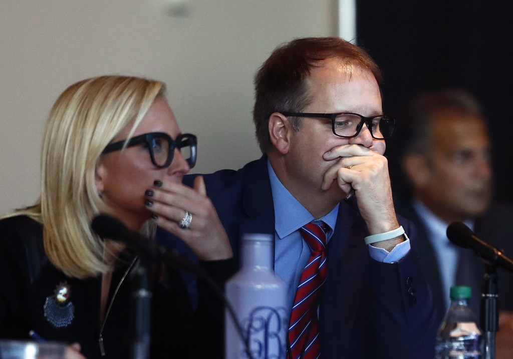 Florida Senator Lauren Book, left, and Ryan Petty, the father of shooting victim Alaina Petty listen to videos from the school shooting during the Mar