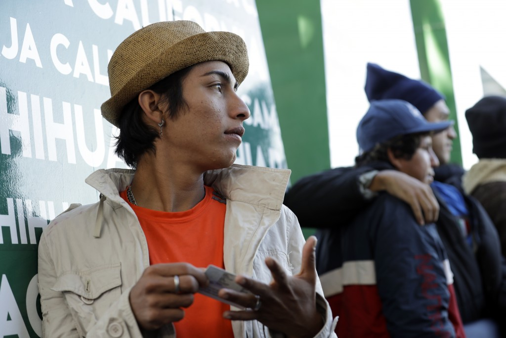 Guatemalan migrant Darwin Sagastume, a member of the LGBQ community, waits in a line of immigrants wishing to apply for asylum in the United States, a