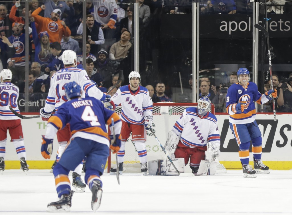 New York Islanders' Anthony Beauvillier (18) celebrates his goal against New York Rangers goaltender Henrik Lundqvist during the first period of an NH