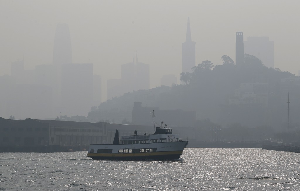 The skyline is obscured by smoke and haze from wildfires as a tour boat makes its way along the waterfront Thursday, Nov. 15, 2018, in San Francisco.