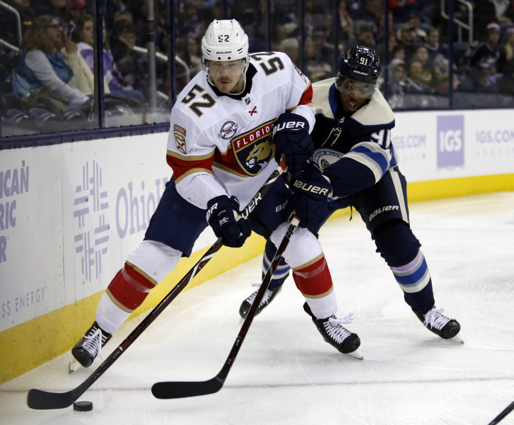 Florida Panthers defenseman MacKenzie Weegar, (52) controls the puck against Columbus Blue Jackets forward Anthony Ducclair during the second period o