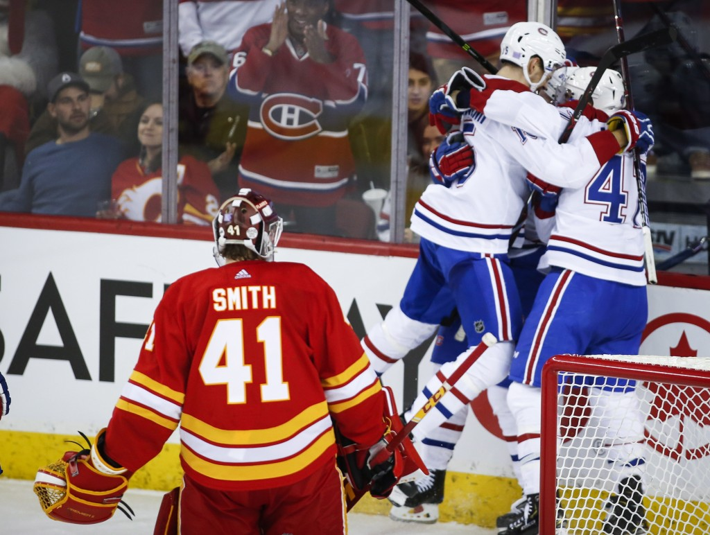 Montreal Canadiens celebrates a goal against Calgary Flames goalie Mike Smith (41) during the third period of an NHL hockey game Thursday, Nov. 15, 20