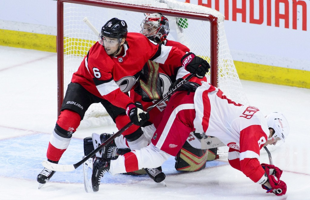 Ottawa Senators defenseman Chris Wideman (6) pushes Detroit Red Wings left wing Justin Abdelkader (8) to the ice during the third period of an NHL hoc