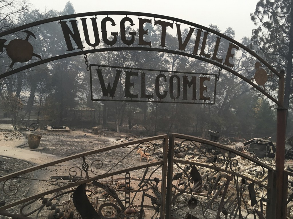 FILE - This Wednesday, Nov. 14, 2018 shows the remains of the Gold Nugget Museum, which was totally demolished by the Camp Fire, in Paradise, Calif. P...