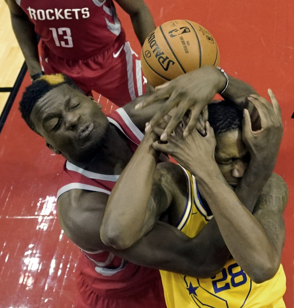 Golden State Warriors' Alfonzo McKinnie (28) is fouled by Houston Rockets' Clint Capela during the second half of an NBA basketball game Thursday, Nov