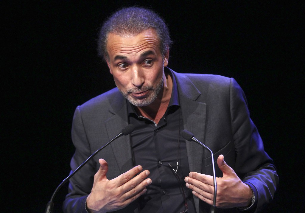 FILE - In this Feb. 7, 2016 file photo, Muslim scholar Tariq Ramadan delivers a speech during a French Muslim organizations meeting in Lille, northern