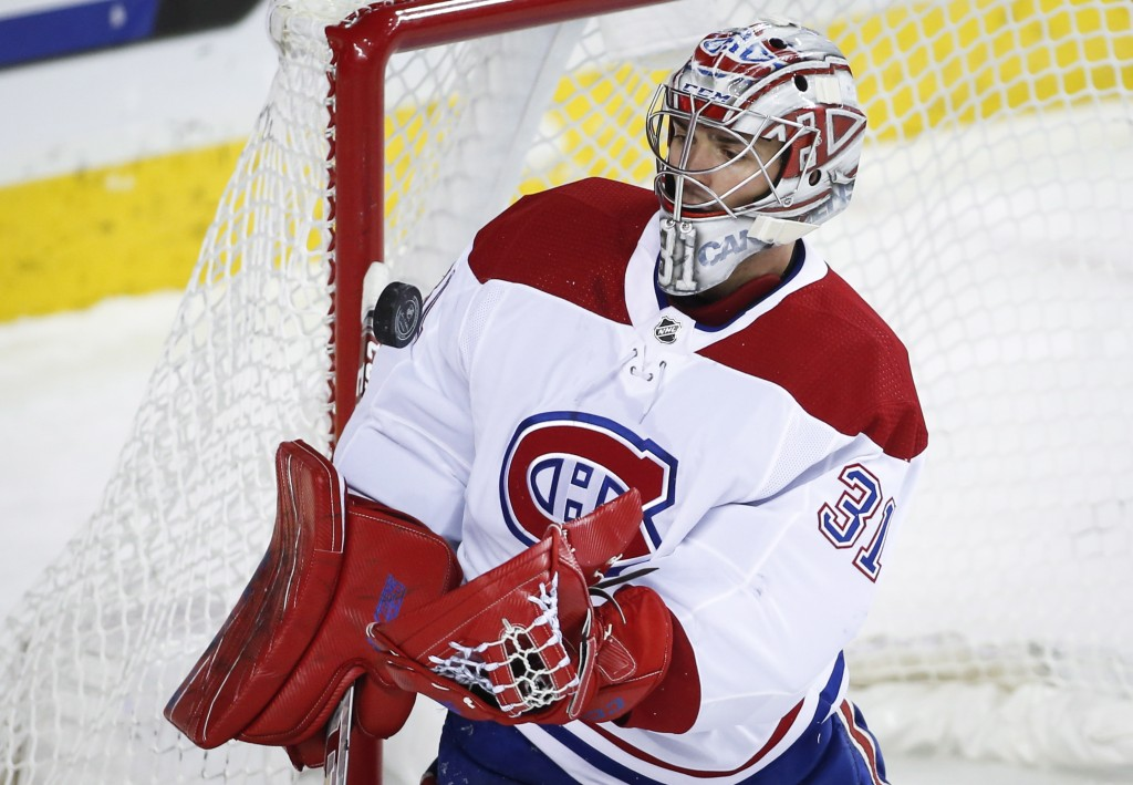 Montreal Canadiens goalie Carey Price grabs the puck during the first period of an NHL hockey game against the Calgary Flames on Thursday, Nov. 15, 20