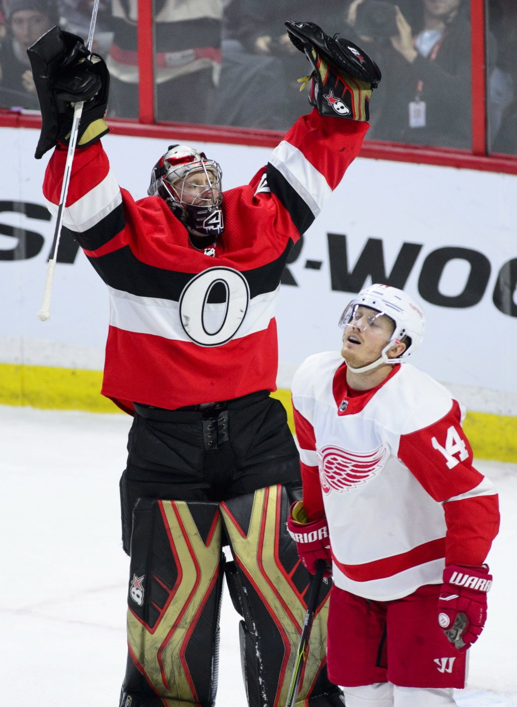 Ottawa Senators goaltender Craig Anderson (41) celebrates a 2-1 win as Detroit Red Wings right wing Gustav Nyquist (14) skates past after an NHL hocke