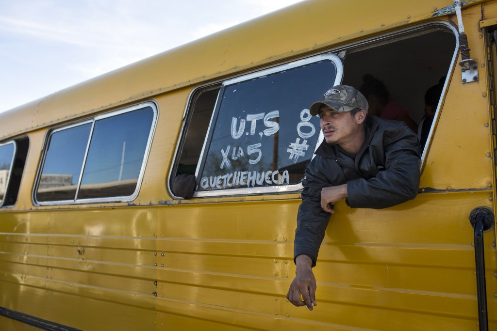 A Central American migrant, part of the caravan hoping to reach the U.S. border, smokes during a stop at a check point in San Luis Rio Colorado in the...