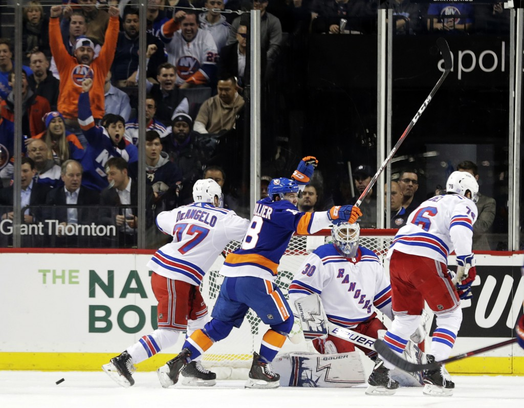 New York Islanders' Anthony Beauvillier (18) celebrates his goal against New York Rangers goaltender Henrik Lundqvist during the first period of an NH...