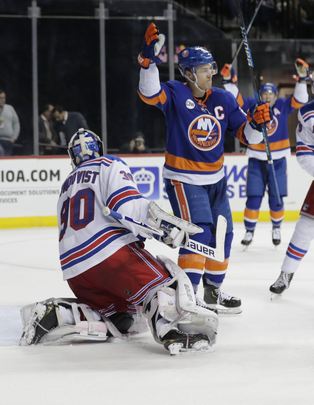 New York Islanders' Anders Lee (27) celebrates after scoring a goal on New York Rangers goaltender Henrik Lundqvist (30) during the second period of a