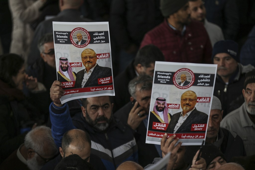 The members of Arab-Turkish Media Association and friends hold posters as they attend funeral prayers in absentia for Saudi writer Jamal Khashoggi who