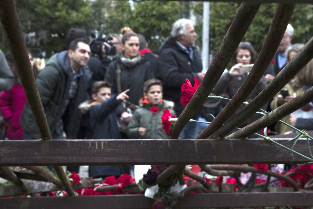 Carnations are placed on the remains of a metal gate crumpled by a tank during the brutal 1973 military crackdown on a student pro-democracy rising, a...
