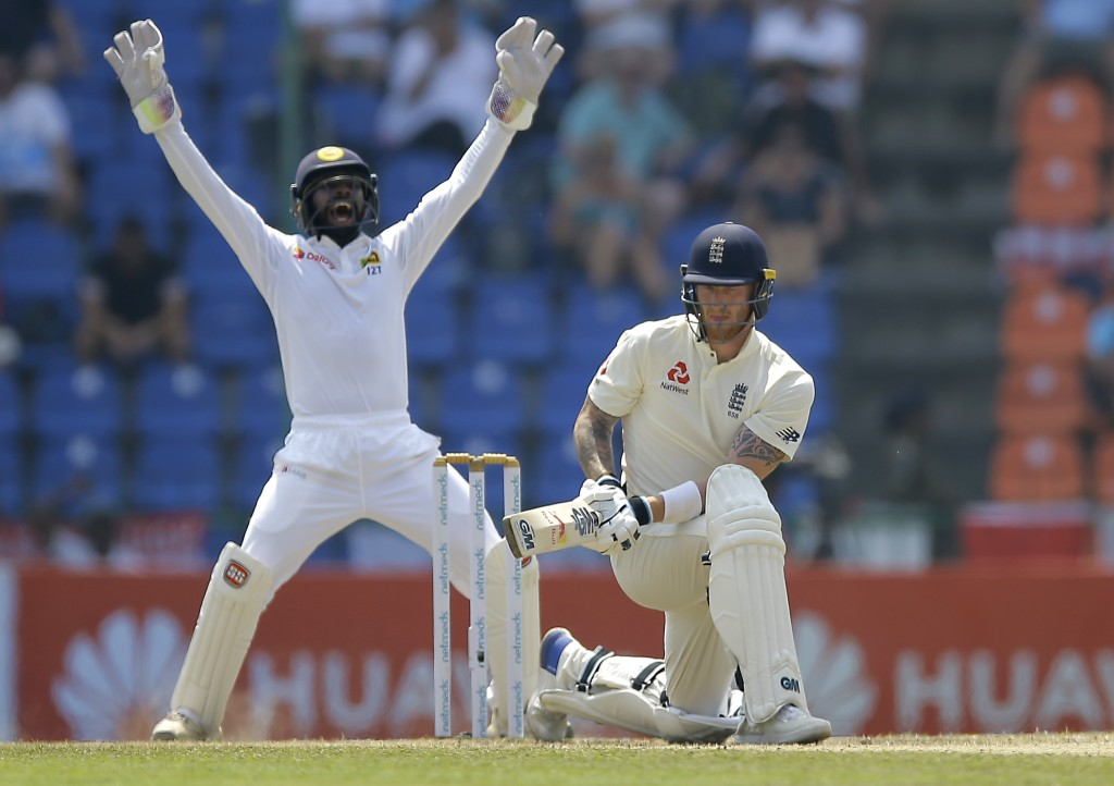 Sri Lanka's wicketkeeper Niroshan Dickwella successfully appeals for the wicket of England's Ben Stokes during the third day's play of the second test...