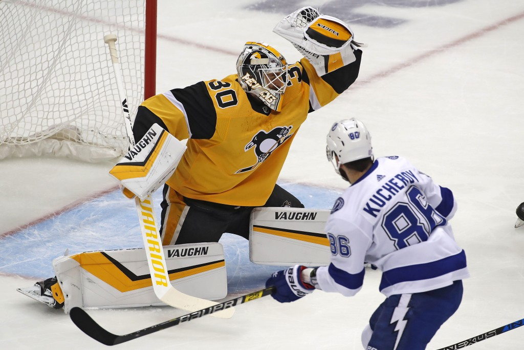 Pittsburgh Penguins goaltender Matt Murray (30) makes a glove save during the first period of the team's NHL hockey game against the Tampa Bay Lightni...