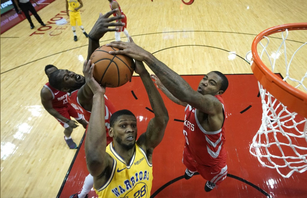 Golden State Warriors' Alfonzo McKinnie (28) goes up for a shot as Houston Rockets' Gary Clark (6) and James Ennis III defend during the second half o