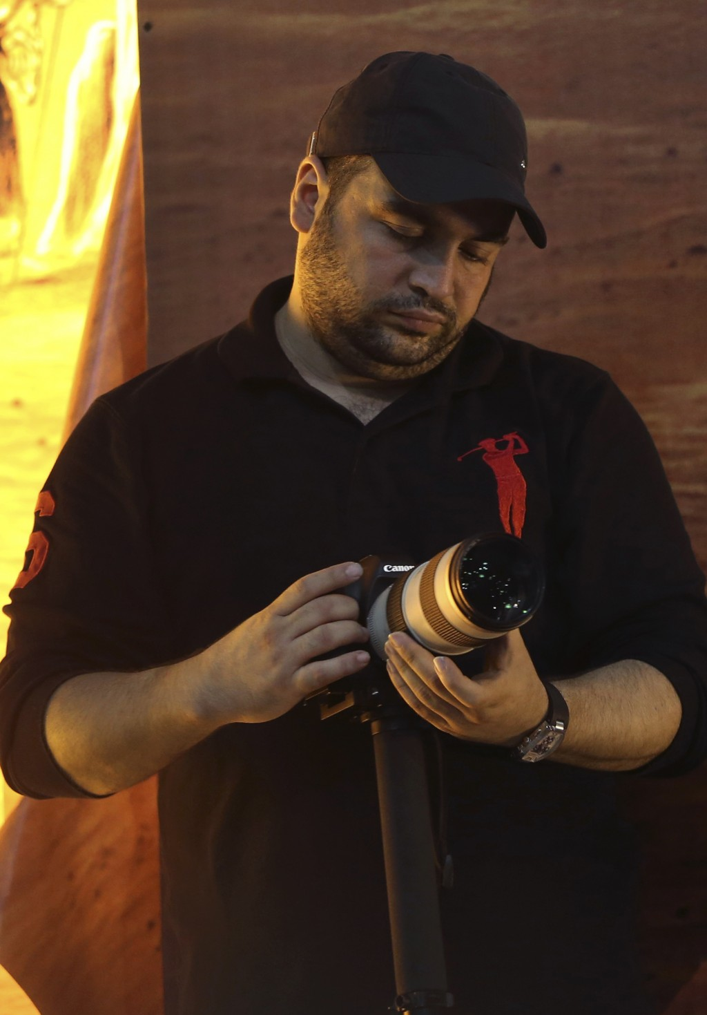 In this Nov. 3, 2014 photo, Jawad Nasrallah, the second eldest son of of Hezbollah leader Sheikh Hassan Nasrallah, adjusts his camera during a speech ...