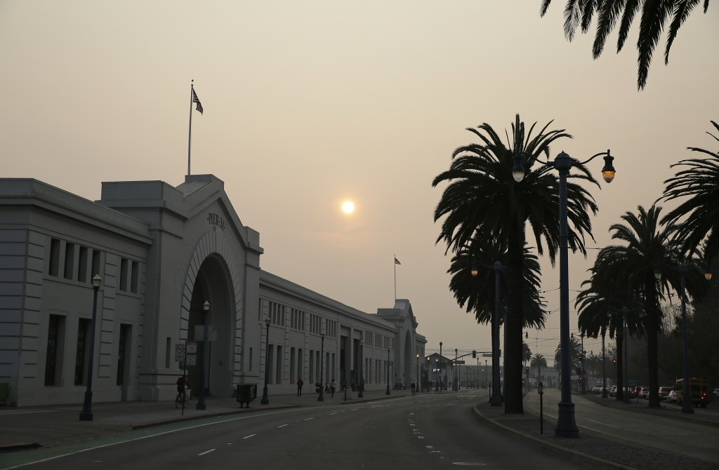 Smoke and haze from wildfires obscures the Embarcadero Thursday, Nov. 15, 2018, in San Francisco. Recurring wildfires are sparking concern among medic