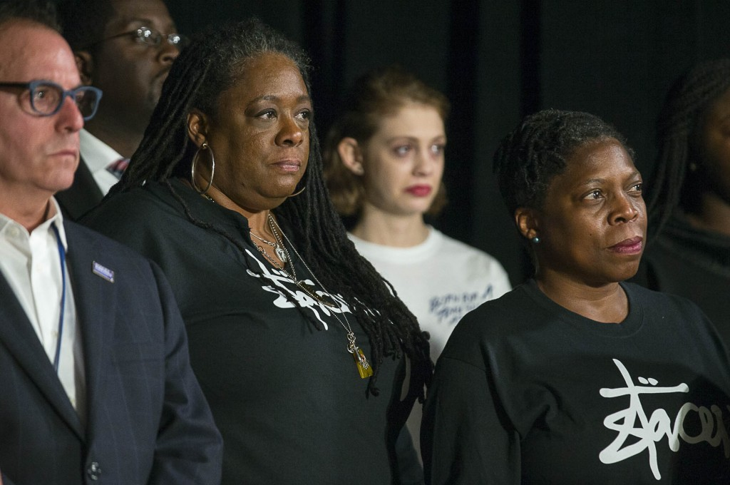 Supporters of Georgia Gubernatorial Democratic candidate Stacey Abrams listen as she ends her campaign during a press conference at the Abrams Headqua