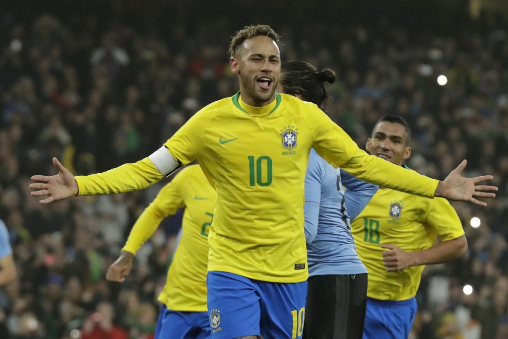Brazil's Neymar celebrates after scoring a penalty during the international friendly soccer match between Brazil and Uruguay at the Emirates Stadium, ...