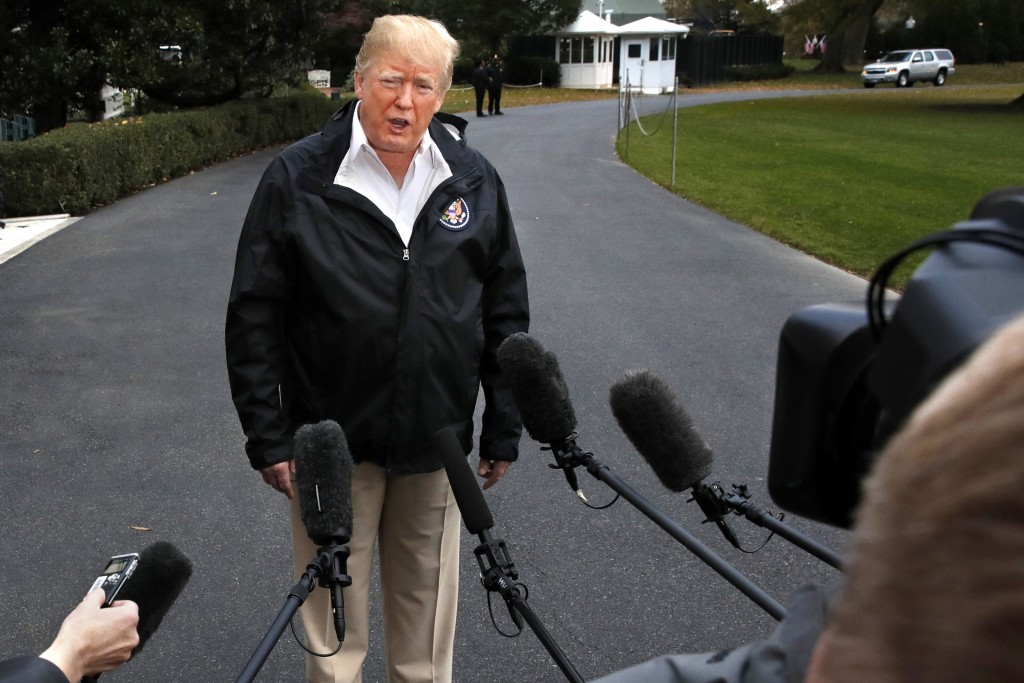 President Donald Trump answers questions from members of the media as he leaves the White House, Saturday Nov. 17, 2018, in Washington, en route to se...
