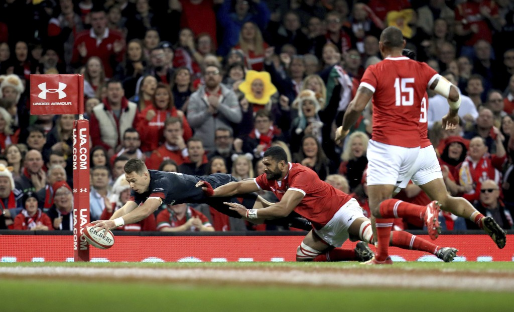 Wales' Liam Williams, left, scores his team's third try during their Autumn International rugby union match at the Principality Stadium, Cardiff, Wale