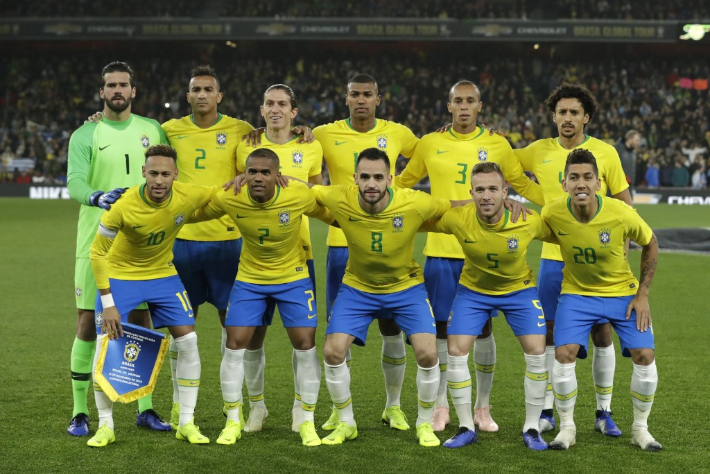 Brazil team pose before the international friendly soccer match between Brazil and Uruguay at the Emirates Stadium, London, Friday, Nov. 16, 2018. (AP