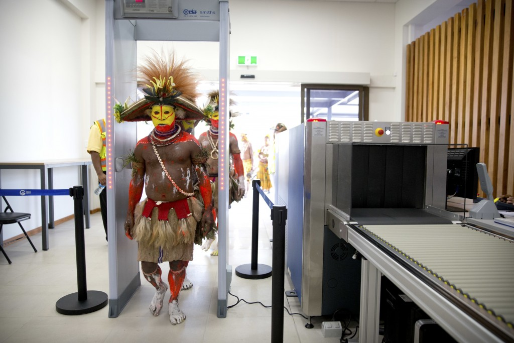 In this Nov. 17, 2018, photo, performers in traditional dresses pass through a security screening at Jacksons International Airport in Port Moresby, P...