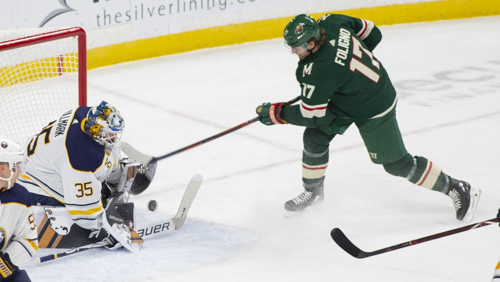 Buffalo Sabres goaltender Linus Ullmark, of Sweden, (35) stops a shot by Minnesota Wild left wing Marcus Foligno (17) during the first period of an NH...