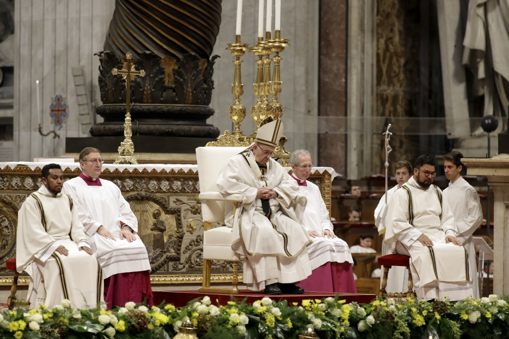 Pope Francis celebrates a mass in St. Peter basilica at the Vatican, Sunday, Nov. 18, 2018. Pope Francis is offering several hundred poor people, home