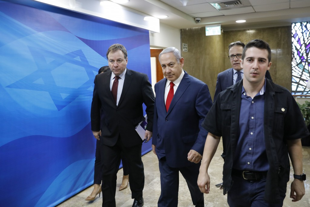 Israeli Prime Minister Benjamin Netanyahu, center, arrives for the weekly cabinet meeting at the prime minister's office in Jerusalem, Sunday, Nov. 18