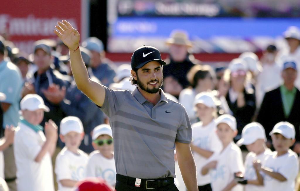 Abraham Ancer of Mexico waves after winning the Australian Open Golf tournament in Sydney, Sunday, Nov. 18, 2018. (AP Photo/Rick Rycroft)