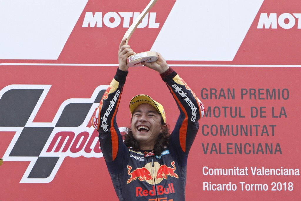 Moto3 KTM rider Can Oncu of Turkey celebrates with the trophy after winning the Moto3 Motorcycle Grand Prix at the Ricardo Tormo circuit in Cheste nea