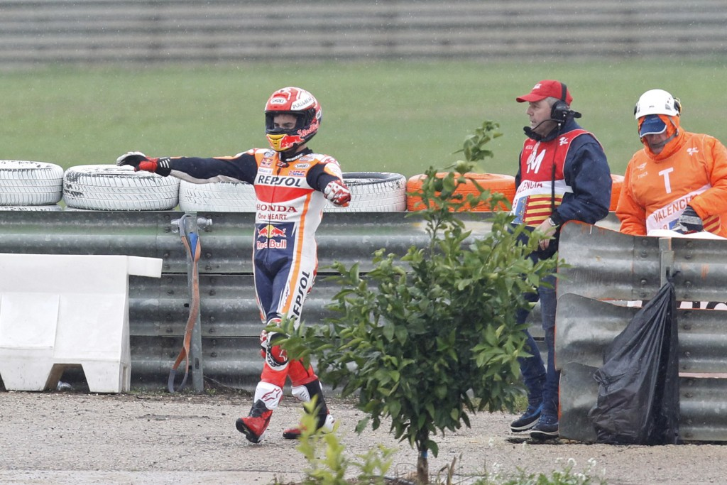 Actual World Champion MotoGP Honda rider Marc Marquez of Spain stretches his arms after falling from his bike during the Motorcycle Grand Prix at the